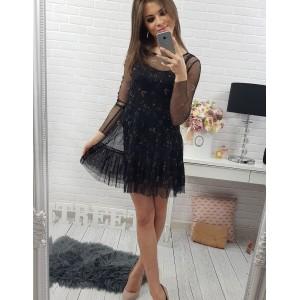 Moderné dámske šaty čiernej farby s jemným vzorom a priesvitnými rukávmi