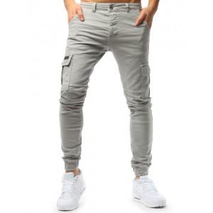 Béžové pánske džínsy so zúženým zakončením nohavíc
