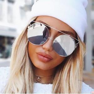 Okrúhle slnečné okuliare strieborné s dizajnovým rámom