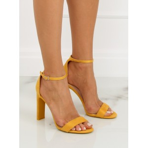 Spoločenské sandále žltej farby na vysokom podpätku