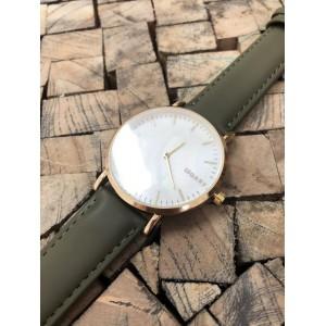 Moderné dámske hodinky so zlatým ciferníkom a zeleným remienkom