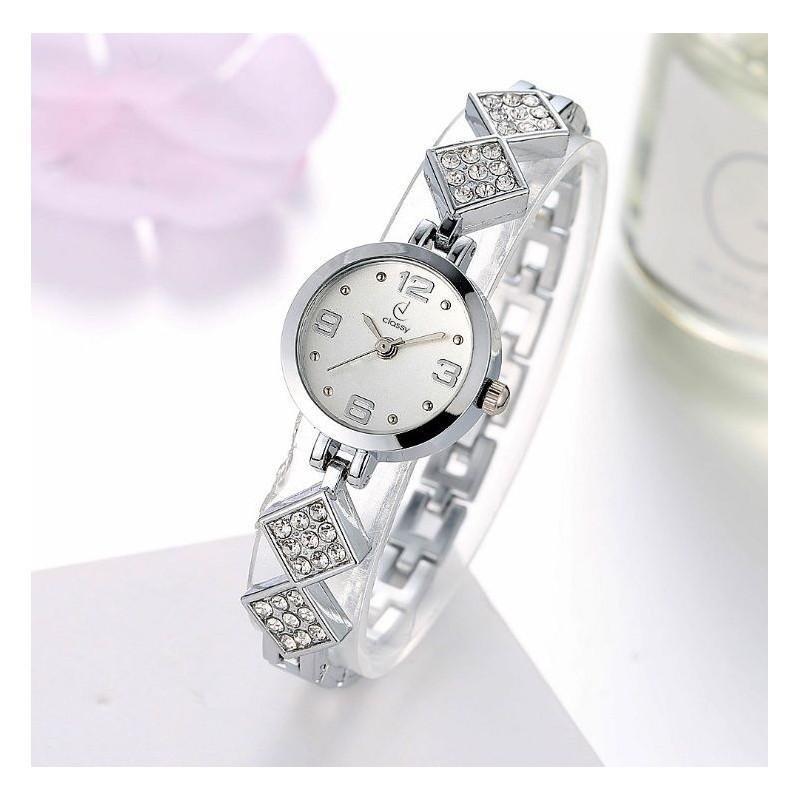 Dámske strieborné hodinky s originálnym remienkom s kryštálikmi 6a527b2a1d3