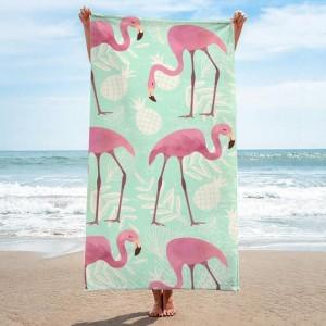 Kvalitný uterák v zelenej farbe s plameniakmi