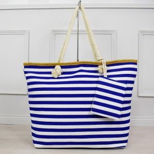 Krásna bielo modrá pruhovaná veľká taška na pláž s vreckom