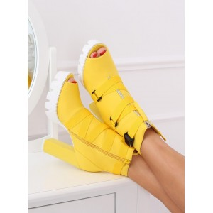 Extravagantné žlté kotníkové topánky na vysokom opätku