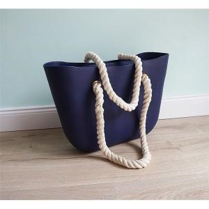 Modrá dámska gumená kabelka s odnímateľnými rúčkami