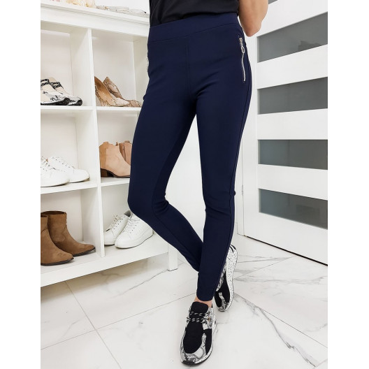 Dámske modré obtiahnuté nohavice s vreckami na zips