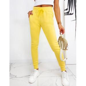Žlté jednofarebné dámske fit tepláky