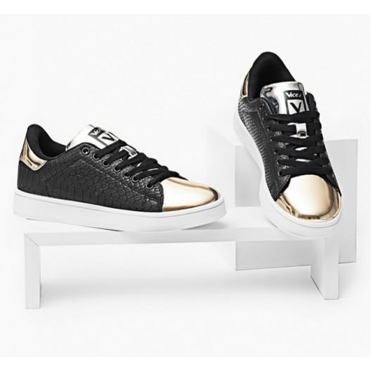 Športové vzorované botasky čiernej farby so zlatou špičkou