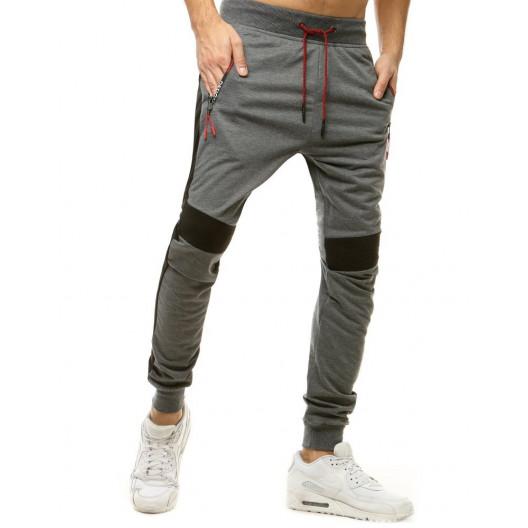 Štýlové pánske sivé tepláky s kontrastnou látkou na kolenách a bokoch