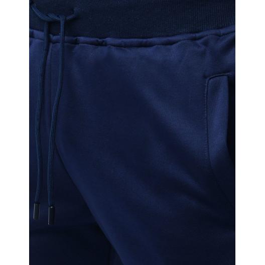 Pohodlné jednofarebné tmavomodré tepláky v jogger štýle