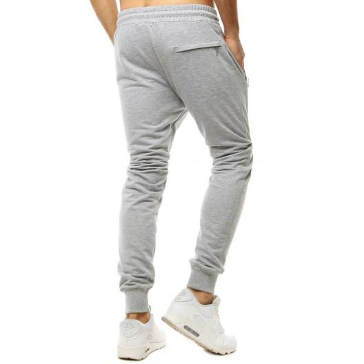 Pohodlné jednofarebné sivé tepláky v jogger štýle