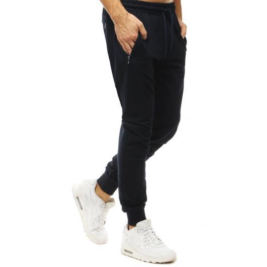 Pánske jednofarebné tmavomodré tepláky v jogger štýle