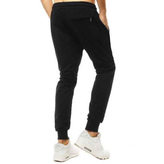 Pánske jednofarebné čierne tepláky v jogger štýle