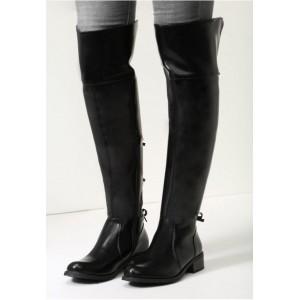 Dámske zimné vysoké čižmy nad kolená v čiernej farbe s mašličkami v zadnej časti na nízkom podpätku