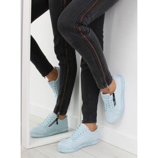 Modré dámske tenisky s nápismi na podrážke