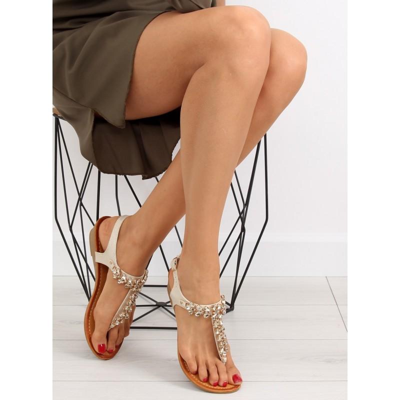 d4b9a566a878 Dámske nízke sandále v zlatej farbe medzi prsty